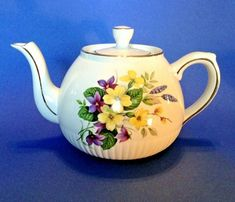 Made In England. White With Purple And Yellow Flowers. And Blue Leaves. With Gold Gilded Accents. Chocolate Pots, Chocolate Coffee, Purple Yellow, Yellow Flowers, Blue Leaves, Gold Gilding, Teacups, Gold Accents, Teapot