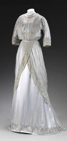 "Dress, made by Pickett, London, c. 1909. Victoria and Albert Museum, London. V&A: ""This delicate evening gown of lilac silk and silk chiffon trimmed with lace was worn by Miss Heather Firbank (1888-1954) in her early 20s. Miss Firbank lived in Mayfair and was presented at court by her mother in 1908. Debutantes were expected to wear light-coloured feminine dresses such as this and it is likely that this garment was worn during Heather's first Society Season."" CLICK FOR LARGER IMAGE."