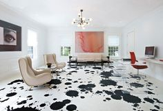 Splatter painted floors! Painting floors is not very common but was the original method of adding colour to flooring in the 1700's. Then we developed all sorts of other materials (stains, carpet, vinyl, etc) and painting became less popular. Some designers have brought it back in a very cool way!