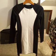 Color block dress NWOT Black and white color block dress material is sweater like and stretchy Forever 21 Dresses