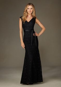 Elegant Long Beaded Lace Bridesmaid Dress Designed by Madeline Gardner. Shown in Black.