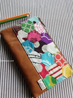 I think sew: The Melinda Zipper Pouch.