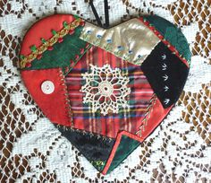 Crazy quilted heart ornament. Size approx 4 inches. Embroidery is all hand done.