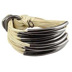 Gillian Julius Multi Tube Bracelet, Iridium   Crème Cord. Multi strand bracelet consisting of 20 waxed cotton cords. Each cord of bracelet features an iridium tube. $275