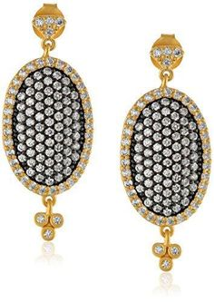 Two tone oval pave drop earrings. The earrings are in fourteen karat gold plated sterling silver and oxidized sterling silver. Designer:Freida Rothman $ 185.00 Item #: ZQRRKP Call 870-863-8818 for personal consultation