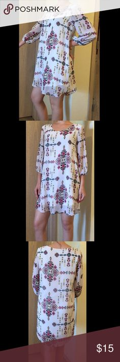 💋 Long Sleeve White Aztec Print Dress White long-sleeve dress. Hits above knees. Colors: white, black, grey, hot pink, baby blue, neon yellow. Excellent summer staple; dress down with sandals for a more casual look or pair with heels for a dressier look! Charming Charlie Dresses Long Sleeve