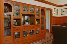 The dining room retains its large built-in buffet with leaded glass.