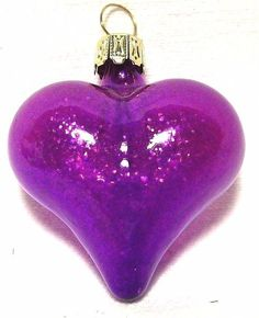 It is a gorgeous violet color, and there is a small amount of silver glitter that is stuck to the inside of the glass, creating this spectacular piece. It has a gold ornament hanger. For sale is aNEW purple heart glass ornament. | eBay!