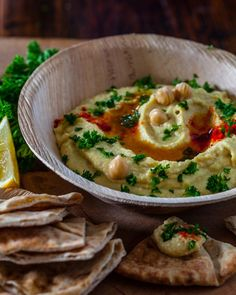 Hummus Recipe One 15-ounce can chickpeas (garbanzo), rinsed and drained well juice from 1 lemon (about 1/4 cup) 3/4 teaspoon kosher or sea salt 1-2 cloves garlic, very finely minced 1/4 cup plain yogurt 3 tablespoons extra virgin olive oil, plus more for drizzling 1/4 teaspoon smoked paprika minced fresh parsley