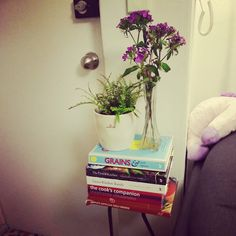 """Stacked books by the door!  #ferns #grains #greenkitchenstories """