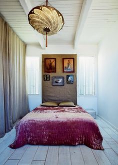 velvet curtains and bed... Wood planked floors.... Somehow it all turns out awesome