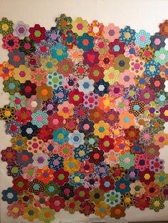 Scrappy hexies! - AMH hexie garden - more progress by Michelle @ i like orange., via Flickr