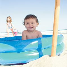 Fill pool with water while on the beach to keep baby cool, safe, and entertained!