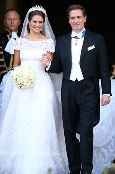 Princess Madeleine of Sweden and Christopher O'Neill depart from the wedding ceremony at The Royal Palace on 8 June 2013 in Stockholm, Sweden.