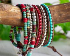 Wrap this gorgeous southwestern inspired leather wrap bracelet around your wrist four times for a great stacking look. With a 3 inch extender the length is adjustable to fit wrist sizes from 5.75 to 7. This bracelet has four sections - the first three sections are red, blue and silver