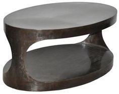 Hand Finished Two Level Oval Metal Coffee Table Finishes Will Vary Slightly Item Has Rustic Appearance That May Include Spotting and Variationsin Tone and Luster  Also Available AsTwo Level Round Metal Side Table