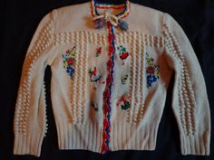 1940's cardigan. All original. Decorated with flowers and people. Great condition.