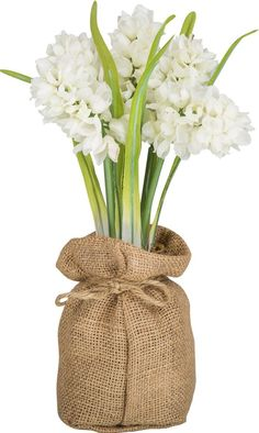 Bring a touch of spring into your home with this hyacinth arrangement. Featuring white hyacinths, a burlap sack gives these artificial flowers a rustic feel. Make this beautiful bunch of hyacinths the centerpiece of your Easter dinner table.