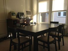 Ikea black dining table and 6 chairs