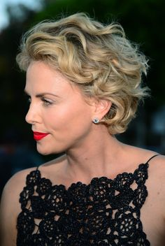 Charlize Theron styled her short hair with windblown curls for the premiere of 'A Million Ways to Die in the West.'