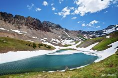 The San Juans in southern Colorado are a high altitude range of mountains that straddle the Continental Divide. This wide-open landscape, at 11,570 feet elevation, is well above timberline. The photograph was taken from Middle Blue Lake in the Mount Sneffels Wilderness, Colorado, USA.
