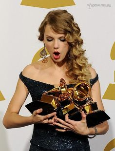 Taylor Swift Grammy Awards  Album of the Year, Best Female Country Vocal Performance, Best Country Song, and Best Country Album at the 52nd Annual Grammy Awards, January 31, 2010