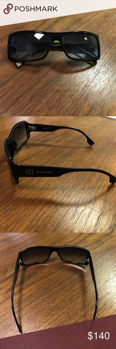 Authentic Men's Hugo Boss Sunglasses Mens. Hugo Boss Orange. Gently used. Black plastic frame. Smoky lenses. Don't know too much of the specifications since my husband didn't save them. Let me know if you have questions I can try to answer. No trades! No lowball offers! Hugo Boss Accessories Sunglasses