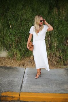 May 20, 2016 Dress: Wayf, Shoes: Stuart Weitzman, Handbag: CHANEL, Sunglasses: Ray-Ban, Bracelets: Cartier, David Yurman, Lip: Laura Gellar Big Red Apple c/o Shop the Look: My latest obsession is the color white. I mean, I have always had a thing for a white tee but this Spring season it's blossomed into items other than tees. Like this new white dress. It's a perfect throw on any day kind of dress. You can dress it up with a little heel for something a bit more dressier or wear it ...