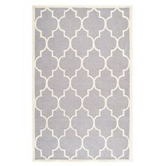 Anchor your living room seating group or define space in the den with this artfully hand-tufted wool rug, featuring a quatrefoil trellis motif for eye-catchi...