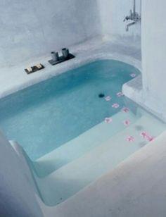 a bathtub built into the ground