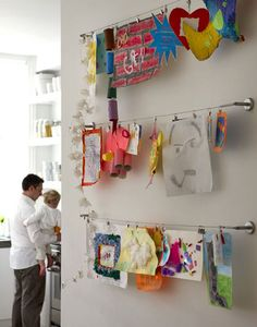 Great idea to hang the kids' artwork on kitchen wall rather than cluttering-up our fridge doors.