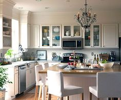 Kitchens: The Hub of the Home..love everything about this kitchen, white on white, large island with chandelier