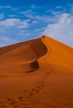 People climbing dune 45 - Namibia