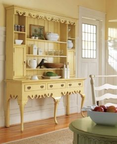 Love this buttery yellow hutch for the kitchen