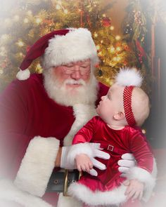 Santa and cute little girl