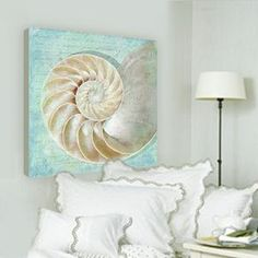 Nautilus Coastal Decor Giclee Artwork Price: $103.99  Our favorite seashell, the Nautilus, created here by talented artist, Suzanne Nicoll. Tranquil background shades give this 24 square coastal decor artwork a subtle charm. Giclee prints are made with archival quality inks on fine art paper which gives each print superior color accuracy and wonderful detail. Each print is mounted on solid birch panels and layers of protective glazing are applied.