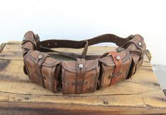 Intricately designed and patina perfection! Features -Swedish Mauser Leather Ammo Belt most likely used during WWI or WWII  -5 Pouches w/leather