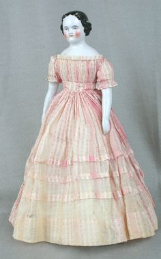 China doll, woman, pink print dress, Germany, 1855-1875. Wisconsin Historical Society. www.wisconsinhistory.org