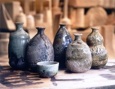 Iga pottery is counted among the 6 old kilns of Japanese pottery. It was founded some 1,200 years ago. It expresses a secret beauty in simplicity through the original enchantment of clay, with the shapes of waves, ear-like projections, designs created with spatulas, glassy sections, dark crimson color, and scorching.