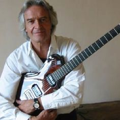 John McLaughlin   ...well, he is famous to me.
