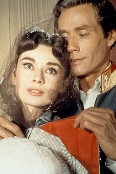 1956 - Hepburn and husband Mel Ferrer in War and Peace, where she went back to loose shoulder-length hair and a curled fringe