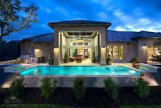 """Designed for the multigenerational family and created with a vision for """"a unified flow of spaces,"""" this San Antonio home is a collaborative effort of Wayne Moravits of Monticello Homes and Mary DeWalt of Mary DeWalt Design Group. The award-winning residence features Series 600 Multi-Slide Doors from Western Window Systems, which blend indoor and outdoor living areas designed around a central courtyard. Rachel Kay, Applebox Imaging."""