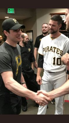 """""""Pittsburgh's top baseball player shaking hands with some of the Pirates"""" Ice Hockey Players, Nhl Players, Baseball Players, Ted Lindsay, 2010 Winter Olympics, Hockey World Cup, Pirates Baseball, Penguin Love"""