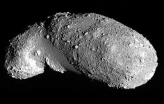 Asteroid Jiggles Like a Jar of Mixed Nuts   >>>   Image of the near-Earth asteroid Itokawa. The boulder-free areas appear relatively smooth and are filled with small, uniformly sized particles.