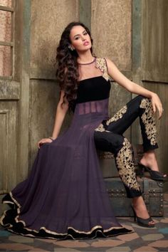 """http://www.istyle99.com/Salwar-Suit/Purple-Semi-Stitched-Georgette-Net-Salwar-Suit-5122.html Purple Semi Stitched Georgette & Net Salwar Suit  Rs 1176.00  Stitch Type: Semi Stitched Occassion Type: Party Wear Kameez Colour: Purple Bottom Colour: Black Dupatta Colour: Black Kameez Fabric: Georgette & Net Bottom Fabric: Santoon Dupatta Fabric: Net Inner:Santoon Work Style: Embroidery TOP LENGTH(Mtr in case of Unstitched): 48"""" CUSTOMIZED UP TO: 44"""" Style Type: Anarkali Neck Style: Round"""