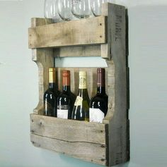 Shipping pallet wine rack. Glasses on shelf above AND hanging below!