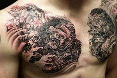 Chest black and grey Foo Dog tattoo