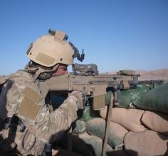 Taking the fight to the Taliban. The rifle is the Scar Heavy, it worked great for me. The optic is 1 to 4 power SpecterDR made by ELCAN. Special Forces, Thing 1