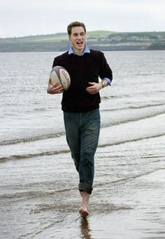 Prince William plays with a rugby ball on the beach at St. Andrews in May 2003. At the time, the prince was two years into a four year History of Art degree at the Scottish university city.