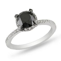 Love this remarkable black diamond engagement ring!
